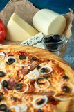 Slice of hot pizza large cheese lunch or dinner crust seafood meat topping sauce. with bell pepper vegetables delicious. Tasty fast food italian traditional on stock photos