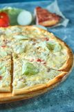 Slice of hot pizza large cheese lunch or dinner crust seafood meat topping sauce. with bell pepper vegetables delicious. Tasty fast food italian traditional on stock images