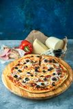 Slice of hot pizza large cheese lunch or dinner crust seafood meat topping sauce. with bell pepper vegetables delicious. Tasty fast food italian traditional on stock photography