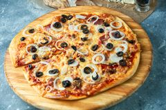 Slice of hot pizza large cheese lunch or dinner crust seafood meat topping sauce. with bell pepper vegetables delicious. Tasty fast food italian traditional on stock photo