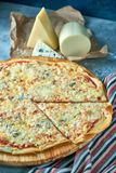 Slice of hot pizza large cheese lunch or dinner crust seafood meat topping sauce. with bell pepper vegetables delicious. Tasty fast food italian traditional on royalty free stock photography