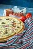 Slice of hot pizza large cheese lunch or dinner crust seafood meat topping sauce. with bell pepper vegetables delicious. Tasty fast food italian traditional on stock image