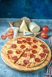Slice of hot pizza large cheese lunch or dinner crust seafood meat topping sauce. with bell pepper vegetables delicious. Tasty fast food italian traditional on royalty free stock photo