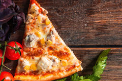 Slice of hot pizza on wood table. Food background. Pizza Fast Food Restaurant Menu Ingredients Italian Cuisine National Concept Stock Photography