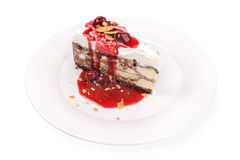 Slice of ice cream cake with jam isolated Royalty Free Stock Photos