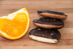Slice of jaffa cake with slice of orange Stock Photography