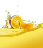 Slice in juice. Orange slice in juice stream Royalty Free Stock Photos