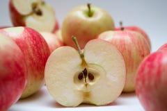 Slice of juicy apple Stock Photos