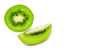 Slice of juicy delicious and healthy ripe kiwi, isolated on white background, copy space, template.  royalty free stock photos