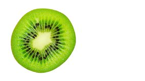 slice of juicy delicious and healthy ripe kiwi, isolated on white background, copy space, template royalty free stock photos