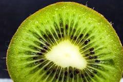 Slice of juicy ripe green kiwi Royalty Free Stock Photo