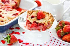 Slice of juicy strawberry pie on a white plate. Holiday strawber. Ry cake selective focus Stock Photography