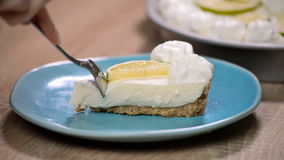 Slice of key lime pie with fresh limes and a garnish. Eat lime cake.  stock video