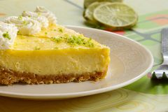 Slice of a key lime pie. On white plate Stock Photography