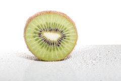 Slice of kiwi with bubbles of mineral water Stock Photo