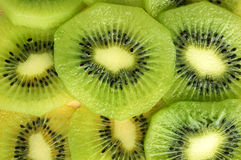 Slice of kiwi fruit background Stock Photos