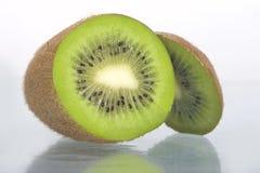 Slice of kiwi fruit. Close-up, kiwifruit slice details isolated on a white background stock photography