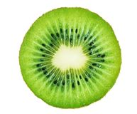 Slice of kiwi fruit isolated on white background. Clipping path included stock photos