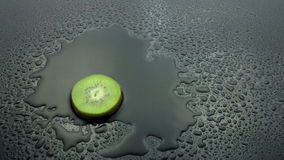 Slice kiwi fruit rinse on wet stock video footage