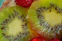 Kiwi and a variety of fresh fruits in sweet gelatin. Berries close-up in soft focus. Delicious dessert. Background of fruit. Food. royalty free stock photos