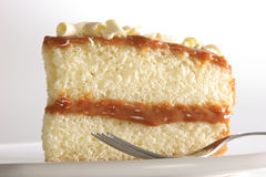 Slice of layered cake. Slice of layered vanilla or lemon cake, stuffed with Dulce de leche (milk jam) is Argentina's traditional desert Royalty Free Stock Photos