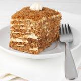 Slice of layered cake Stock Photography