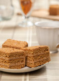 Slice of layered honey cake. Close up royalty free stock images
