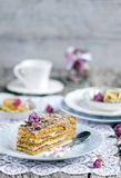 Slice of layered honey cake Stock Photo