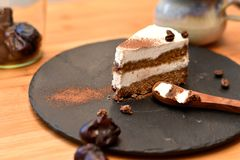 Slice of layered organic raw tiramisu cake stock images