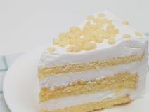 Slice of layered vanilla or lemon cake, stuffed with Stock Photos
