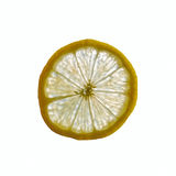 Slice of lemon in backlight. Yellow slice of lemon in backlight with white background Royalty Free Stock Image