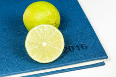 Slice of lemon on blue diary. Of year 2016 Stock Images