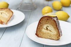 Slice of Lemon Bundt Cake. Slice of lemon cream cheese bundt cake with cream cheese filling in the center. Extreme shallow depth of field with selective focus on stock photography