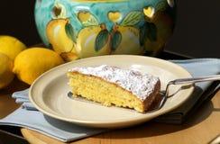 Slice of lemon cake. On wooden tray Royalty Free Stock Images