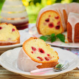 A Slice of Lemon and Caraway Seed Bundt Cake with Raspberries Stock Photography