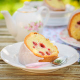 A Slice of Lemon and Caraway Seed Bundt Cake with Raspberries Royalty Free Stock Photography