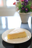 Slice of lemon cheese cake Stock Images