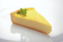 Slice of lemon cheese cake. On the white plate Stock Photography