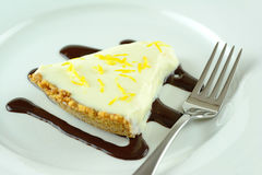 A slice of lemon cheesecake dessert Royalty Free Stock Photos