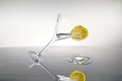 Slice of lemon on a cocktail Stock Images