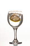 Slice of lemon drops in a glass of water Royalty Free Stock Photos