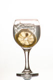 Slice of lemon drops in a glass of water Royalty Free Stock Image
