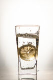 Slice of lemon drops in a glass of water Royalty Free Stock Photography