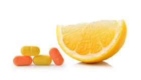 Slice of lemon fruit and vitamin c  on white background Stock Photography