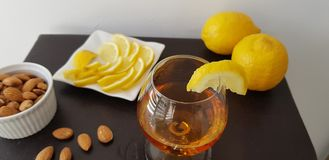A slice of lemon on glass with brandy royalty free stock photo