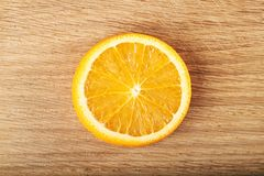 A slice of lemon, isolated on a wooden background Stock Photography