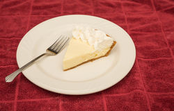 Slice of Lemon Meringue Pie on Red Towel Stock Photo