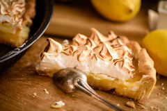 Slice of lemon meringue tart royalty free stock photography
