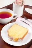 Slice of lemon sponge cake with tea Royalty Free Stock Photography