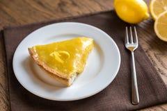 Slice of lemon tart on the plate Stock Images